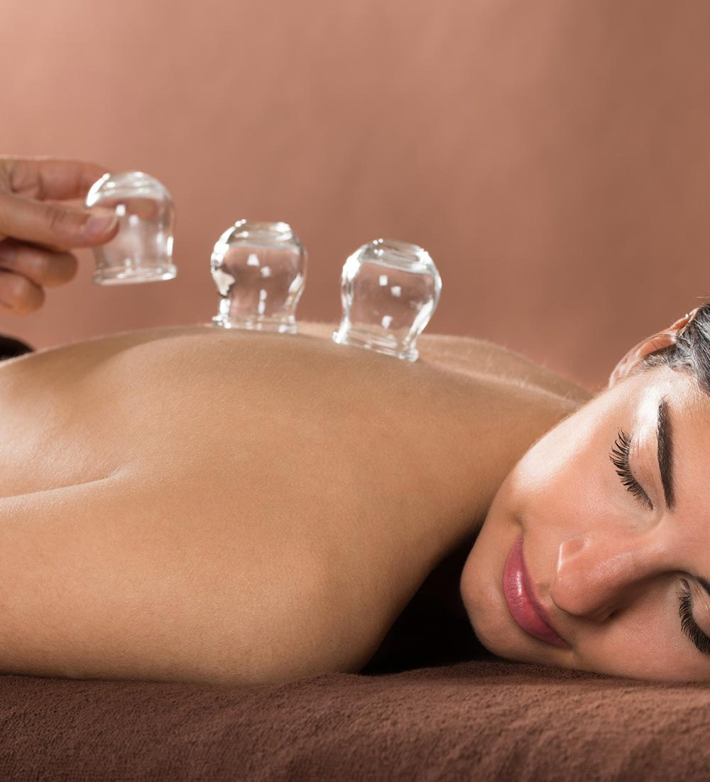Woman having cupping massage